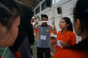 Maerim Wittayakhom studet, view explaining blindfolding hame to her group