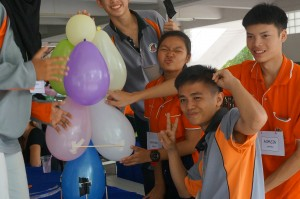 Thai and Malaysian students working on a team building activity, tallest tower from balloons
