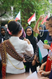 Thai students welcoming malaysia students with jasmine garland